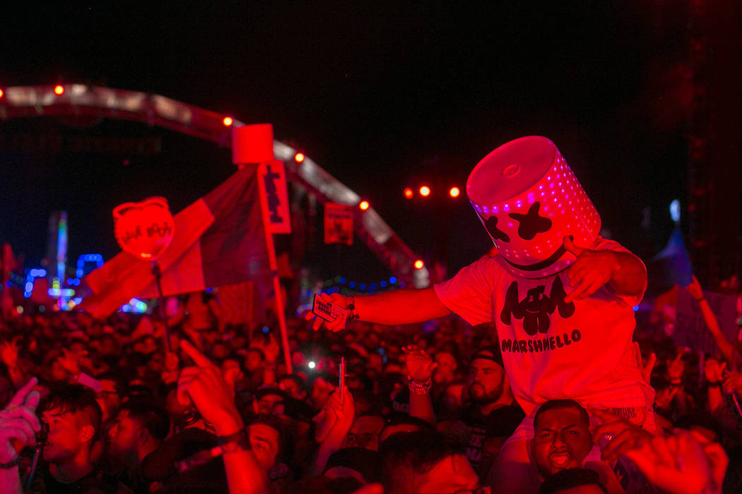 Attendees dance during Marshmello's set at Kinetic Field on the last night of Electric Daisy Carnival at Las Vegas Motor Speedway on Monday, June 19, 2017 in Las Vegas. Bridget Bennett Las Vegas R ...