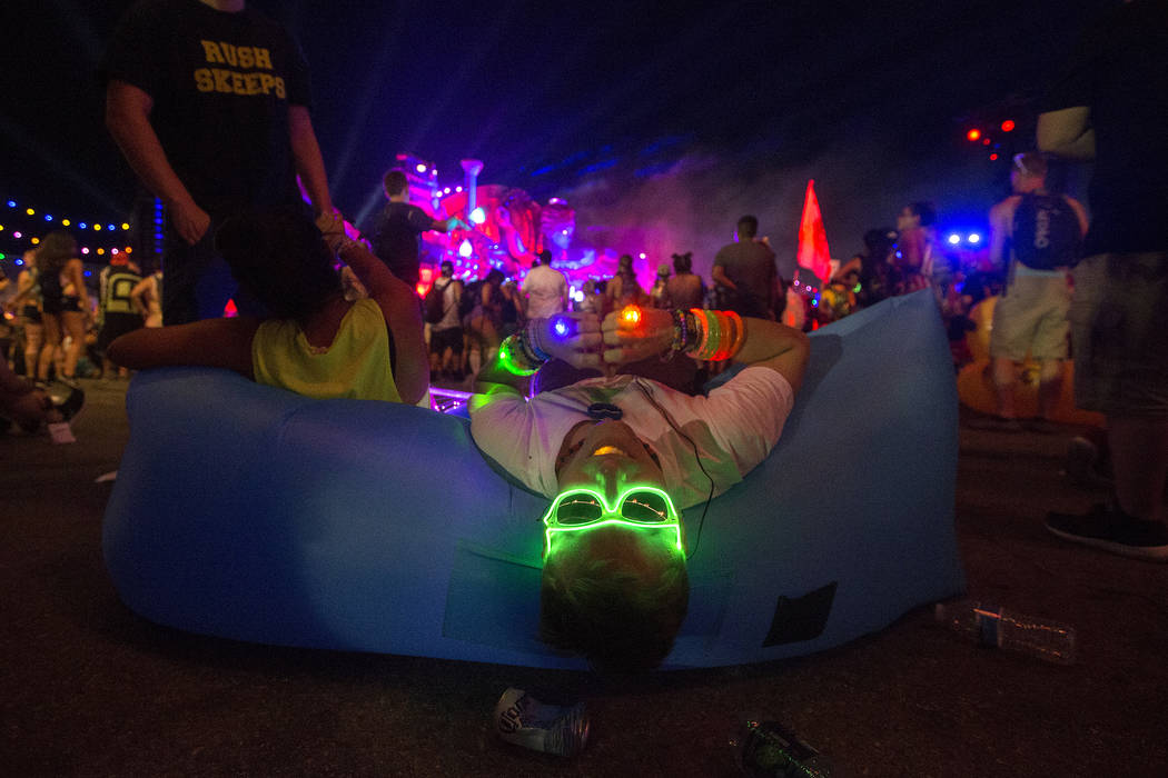 Dan Girvan from Boston rests as Diplo, Jauz and Alison Wonderland play a collaborative set at Kinetic Field on the last night of Electric Daisy Carnival at Las Vegas Motor Speedway on Monday, June ...
