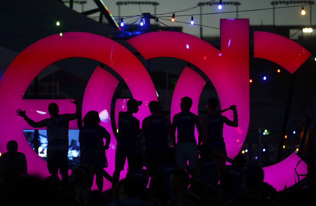Fans are silhouetted as they pose for photos during the last day of the Electric Daisy Carnival at the Las Vegas Motor Speedway on Sunday, June 18, 2017. Chase Stevens Las Vegas Review-Journal @cs ...