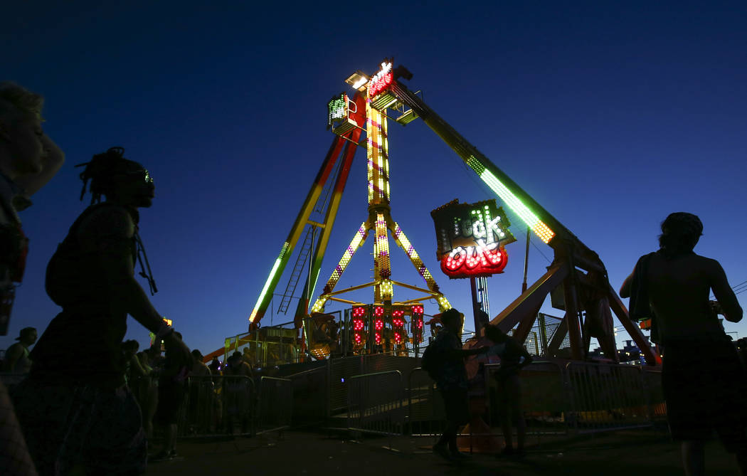 Fans walk by a carnival ride during the last day of the Electric Daisy Carnival at the Las Vegas Motor Speedway on Sunday, June 18, 2017. Chase Stevens Las Vegas Review-Journal @csstevensphoto