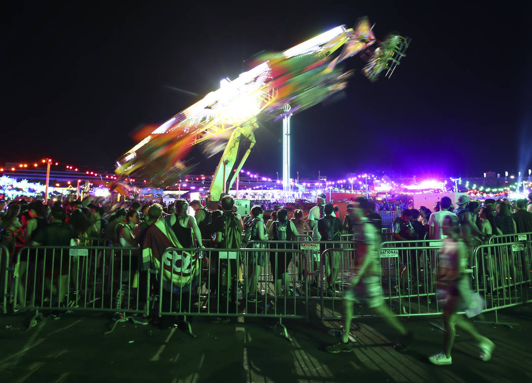 Attendees line up for a carnival ride during the last day of the Electric Daisy Carnival at the Las Vegas Motor Speedway on Sunday, June 18, 2017. Chase Stevens Las Vegas Review-Journal @csstevens ...