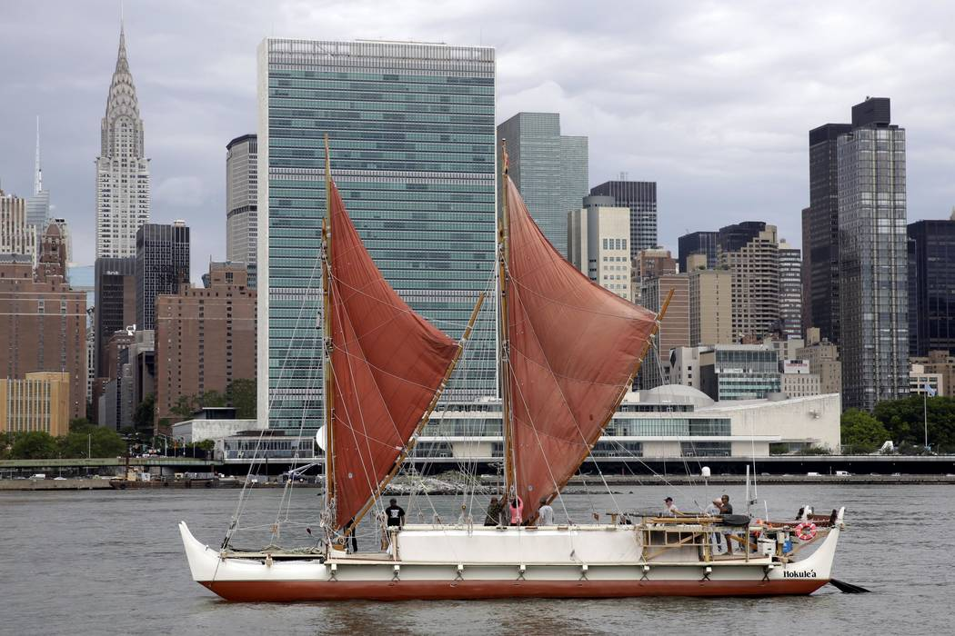 In this June 8, 2016, file photo, the traditional Polynesian voyaging canoe Hokulea, on an around-the-world journey, sails by the United Nations on New York's East River, during the World Oceans D ...