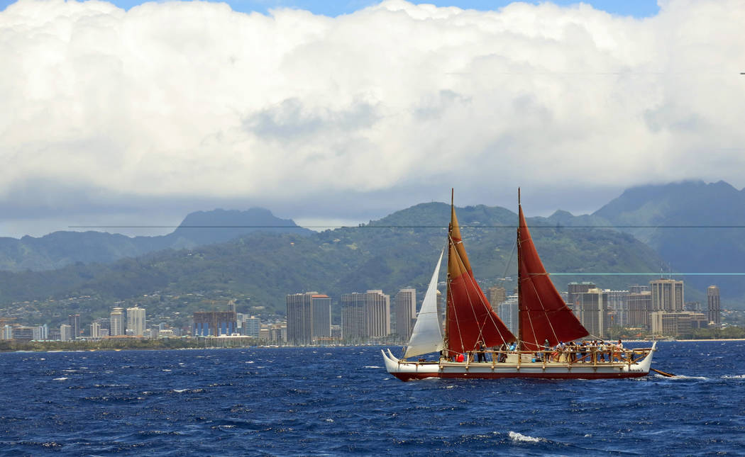 FILE - In this April 29, 2014 file photo, the Hokulea sailing canoe is seen off Honolulu. The Polynesian voyaging canoe is returning to Hawaii after a three-year journey around the world guided on ...