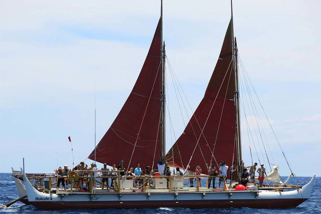 In this April 29, 2014 file photo, the Hokulea sailing canoe is seen off Honolulu. The Polynesian voyaging canoe is returning to Hawaii after a three-year journey around the world guided only by n ...