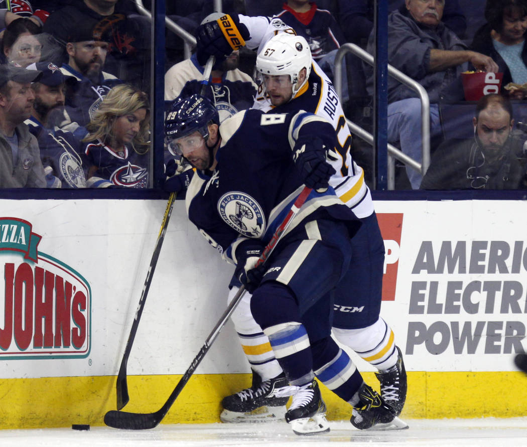 Columbus Blue Jackets forward Sam Gagner, left, works against Buffalo Sabres defenseman Brady Austin during an NHL hockey game in Columbus, Ohio, Tuesday, March 28, 2017. The Blue Jackets won 3-1. ...