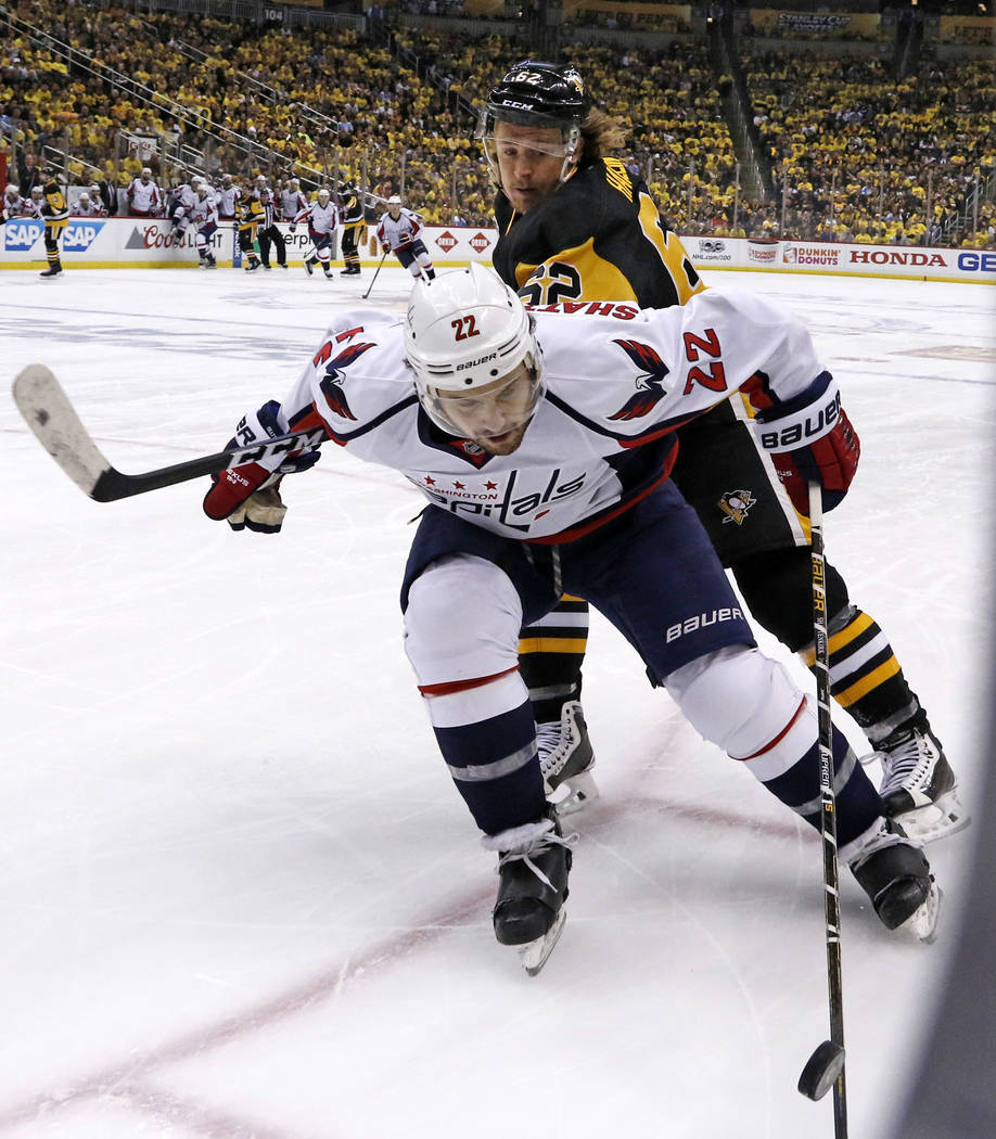 Washington Capitals' Kevin Shattenkirk (22) battles with Pittsburgh Penguins' Carl Hagelin (62) for control of the puck during the second period of Game 6 in the second-round of the NHL hockey Sta ...