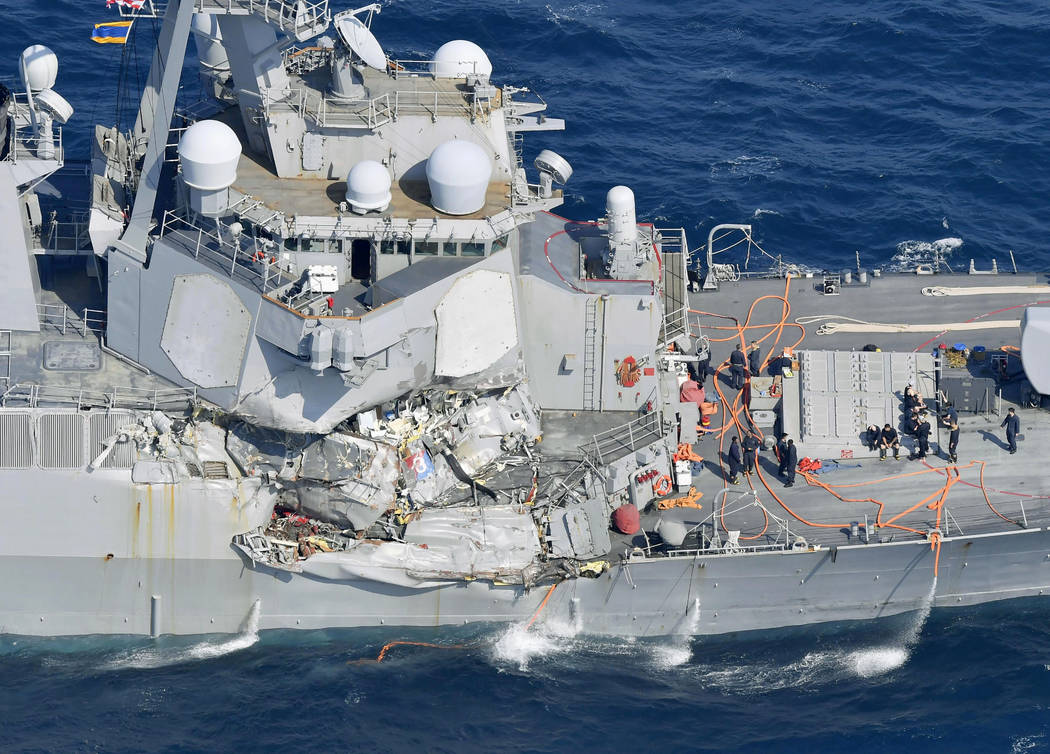 The damage of the right side of the USS Fitzgerald is seen off Shimoda, Shizuoka prefecture, Japan, after the Navy destroyer collided with a merchant ship, Saturday,  June 17, 2017.  The U.S. Navy ...