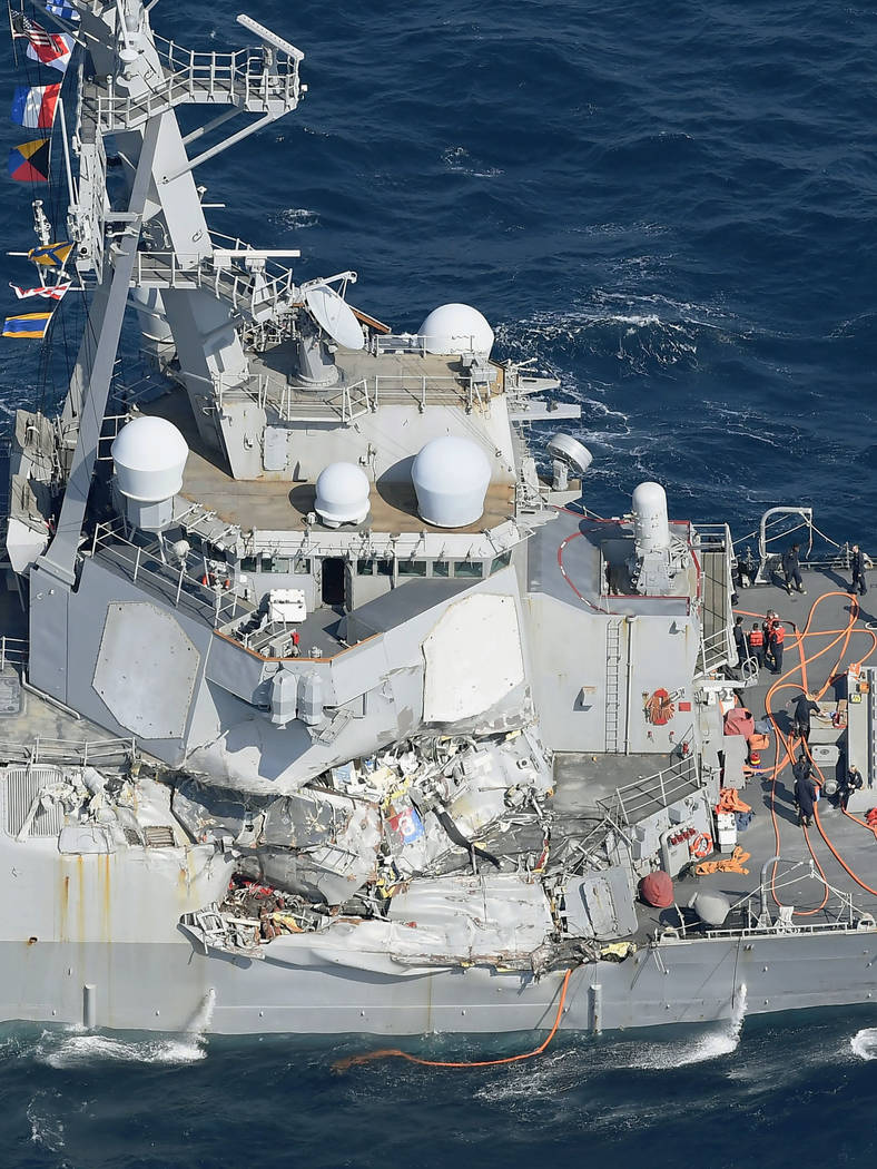 CORRECTS DATE  - The damage of the right side of the USS Fitzgerald is seen off Shimoda, Shizuoka prefecture, Japan, after the Navy destroyer collided with a merchant ship, Saturday, June 17, 2017 ...