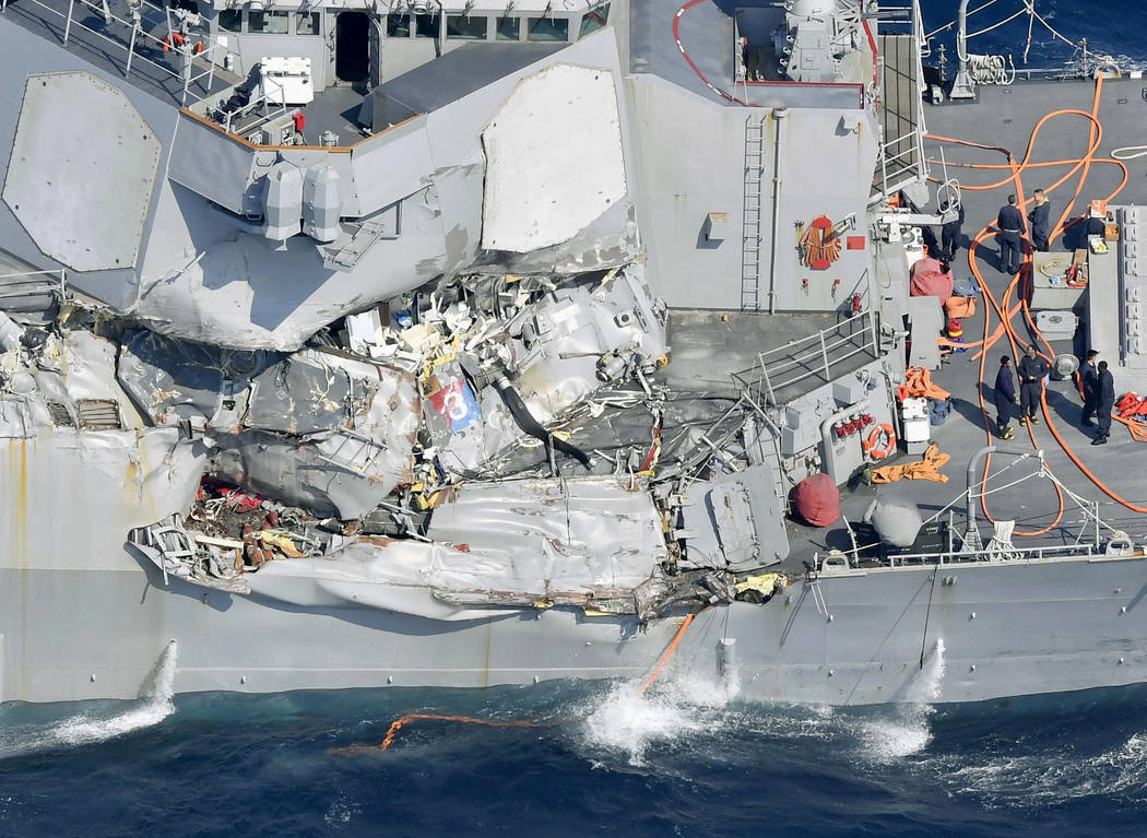 The damage of the right side of the USS Fitzgerald is seen off Shimoda, Shizuoka prefecture, Japan, after the Navy destroyer collided with a merchant ship, Saturday,  June 17, 2017.   Seven Navy s ...