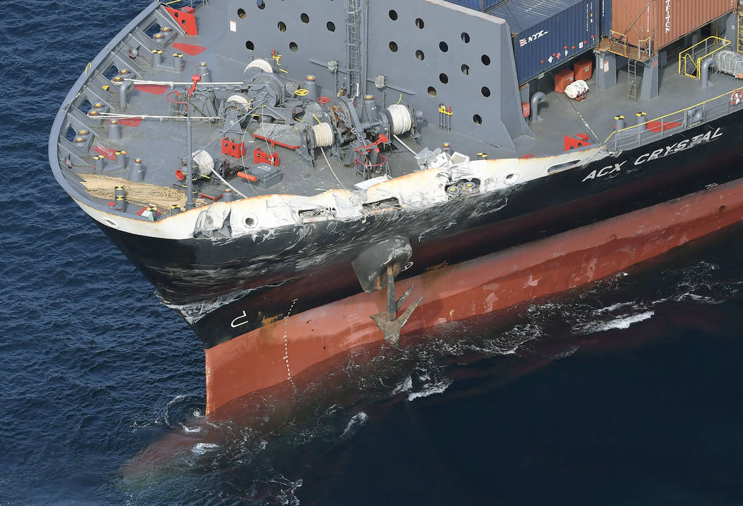 The damage of Philippine-registered container ship ACX Crystal is seen off Izu Oshima,  Japan, after it collided with the USS Fitzgerald, Saturday, June 17, 2017.  The Japan coast guard said it re ...