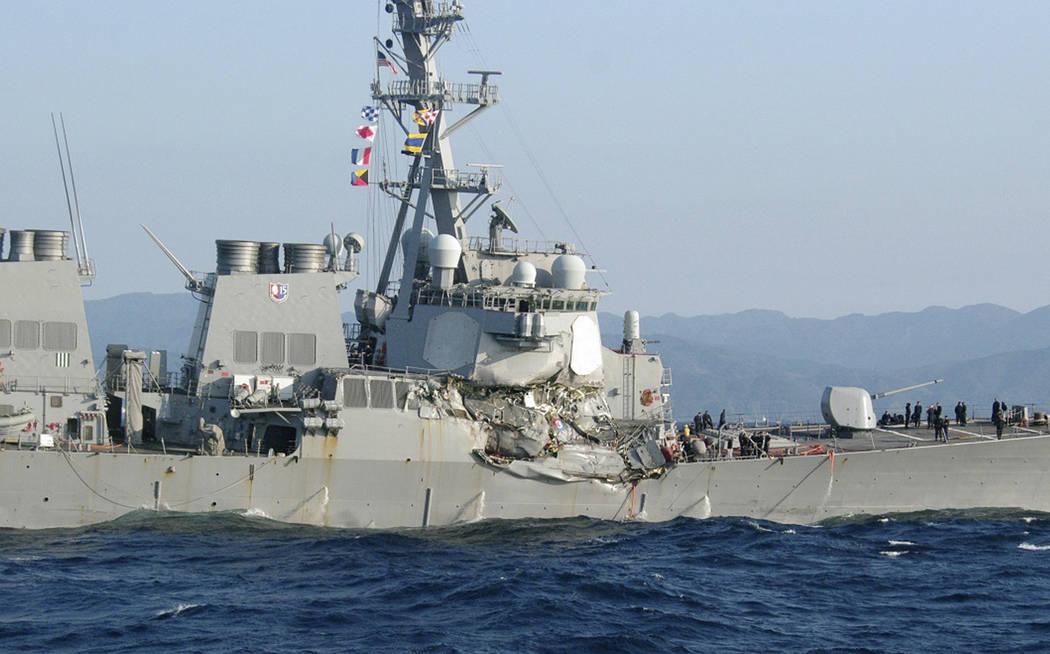 In this photo provided by Japan's 3rd Regional Coast Guard Headquarters, the USS Fitzgerald is seen off Izu Peninsula in, Japan, after the Navy destroyer collided with a merchant ship, Saturday,   ...