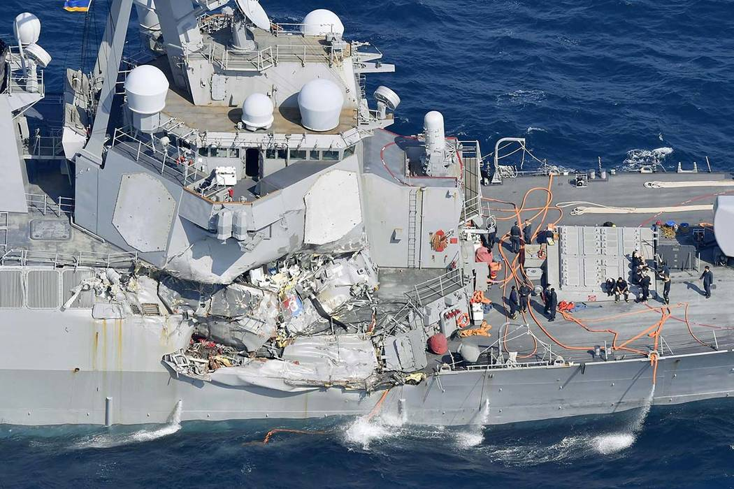 The damage of the right side of the USS Fitzgerald is seen off Shimoda, Shizuoka prefecture, Japan, after the Navy destroyer collided with a merchant ship, Saturday,  June 17, 2017.  (Iori Sagisaw ...