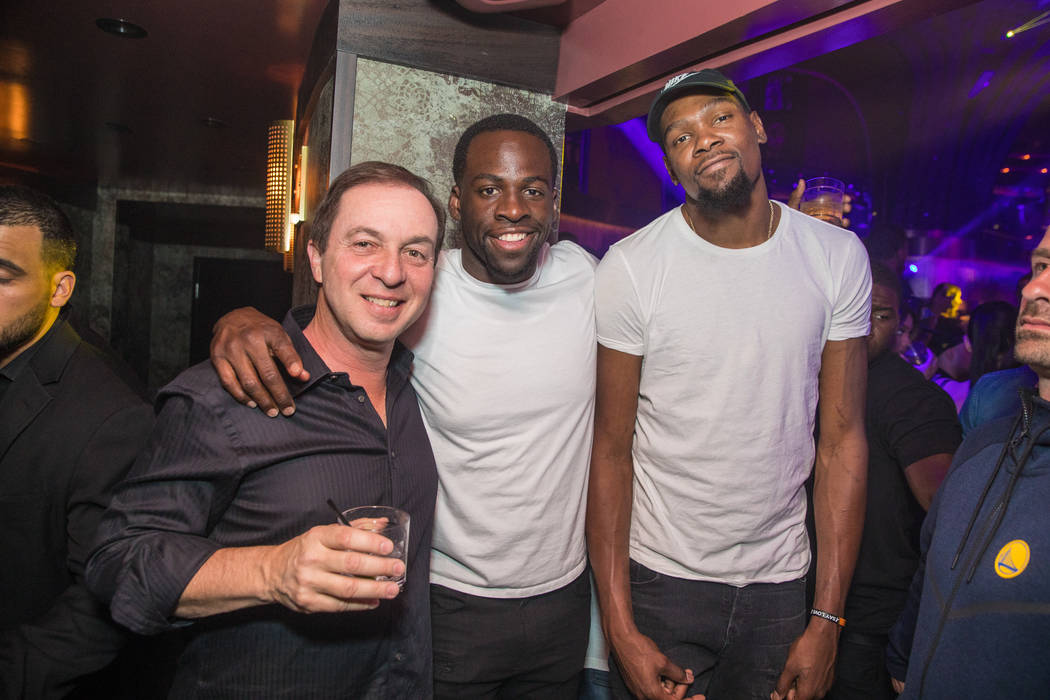 Team co-owner Joseph Lacob, Draymond Green and Kevin Durant of the Golden State Warriors and celebrate the Warriors' NBA championship at Jewell Nightclub at Aria on Friday, June 16, 2017. (Tony Tr ...