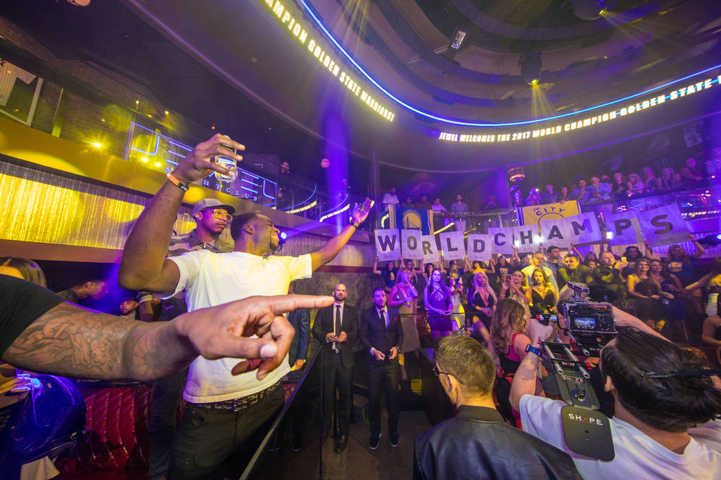 Draymond Green of the Golden State Warriors addresses the throng while celebrating the Warriors' NBA championship at Jewell Nightclub at Aria on Friday, June 16, 2017. (Tony Tran Photography)