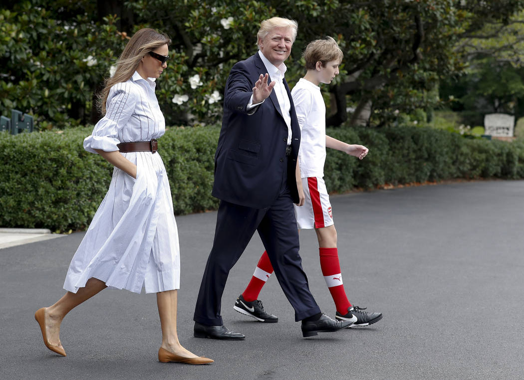 President Donald Trump, first lady Melania Trump, and their son and Barron Trump, walk to Marine One across the South Lawn of the White House in Washington, Saturday, June 17, 2017, en route to Ca ...