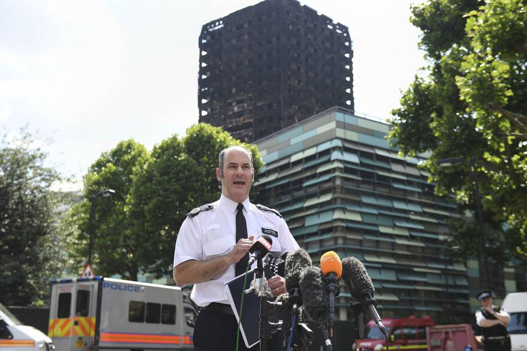 Metropolitan Police Commander Stuart Cundy speaks to the media near Grenfell Tower after a fire engulfed the 24-storey building, in London, Saturday June 17, 2017. London police sa ...