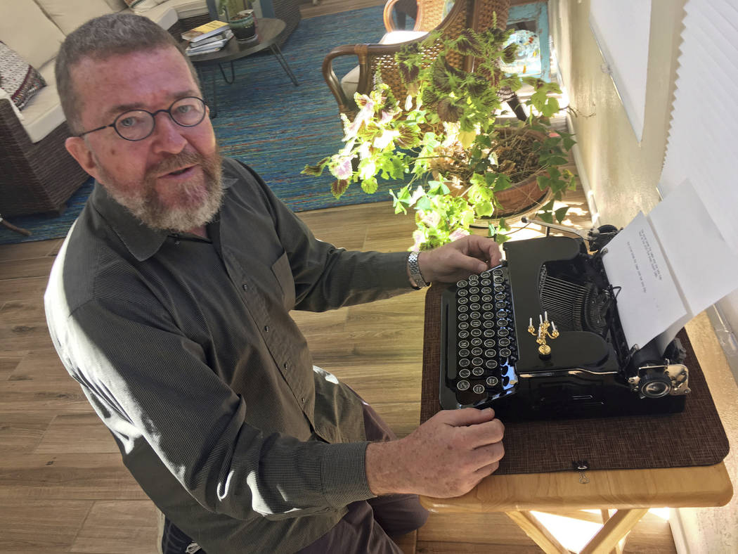 Joe Van Cleave, who runs a popular YouTube channel on restoring typewriters, speaks about one of his vintage typewriters at his home in Albuquerque, N.M., in April. (AP Photo/Russell Contreras)