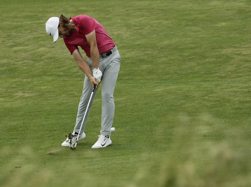 Tommy Fleetwood, of England, hits on the fifth hole during the third round of the U.S. Open golf tournament Saturday, June 17, 2017, at Erin Hills in Erin, Wis. (AP Photo/A Charlie Riedel)