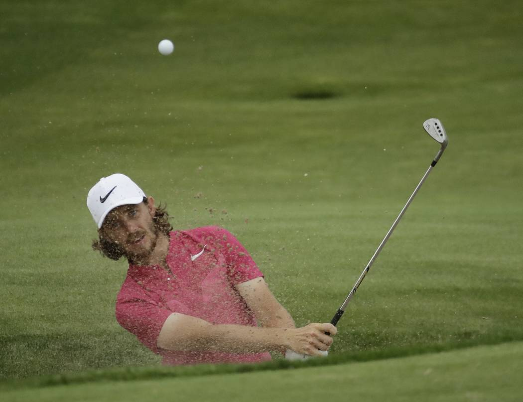 Tommy Fleetwood, of England, hits from a bunker on the 15th hole during the third round of the U.S. Open golf tournament Saturday, June 17, 2017, at Erin Hills in Erin, Wis. (AP Photo/A Charlie Ri ...