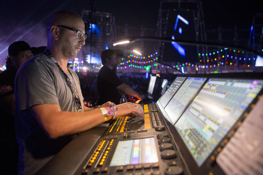 Steve Lieberman works the lights at Circuit Grounds on the first night of Electric Daisy Carnival at Las Vegas Motor Speedway in the early morning of Saturday, June 17, 2017 in Las Vegas. (Bridget ...