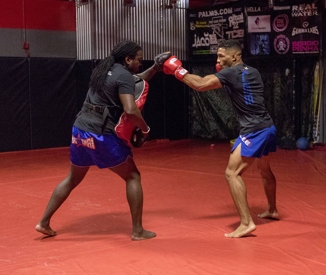 UFC lightweight Kevin Lee, right, works out with his striking coach Dewey Cooper at One Kick's Gym in Las Vegas, Tuesday, June 6, 2017. Heidi Fang /Las Vegas Review-Journal @HeidiFang