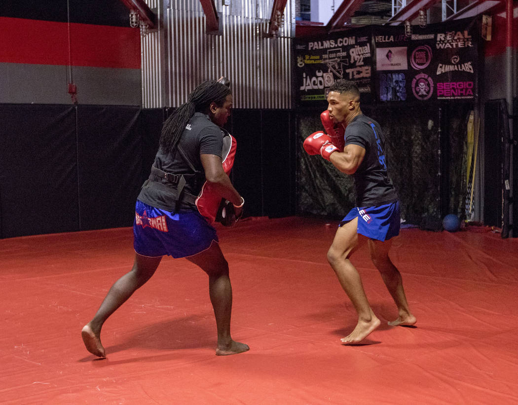 UFC lightweight Kevin Lee, right, prepares to hit mitts with his striking coach Dewey Cooper at One Kick's Gym in Las Vegas, Tuesday, June 6, 2017. Heidi Fang /Las Vegas Review-Journal @HeidiFang