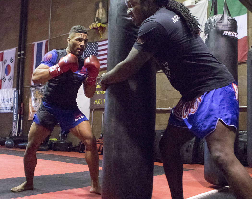 UFC lightweight Kevin Lee, left, trains for his five-round fight at UFC Fight Night 112 with his striking coach Dewey Cooper in Las Vegas at One Kick's Gym on Tuesday, June 6, 2017. Heidi Fang /La ...