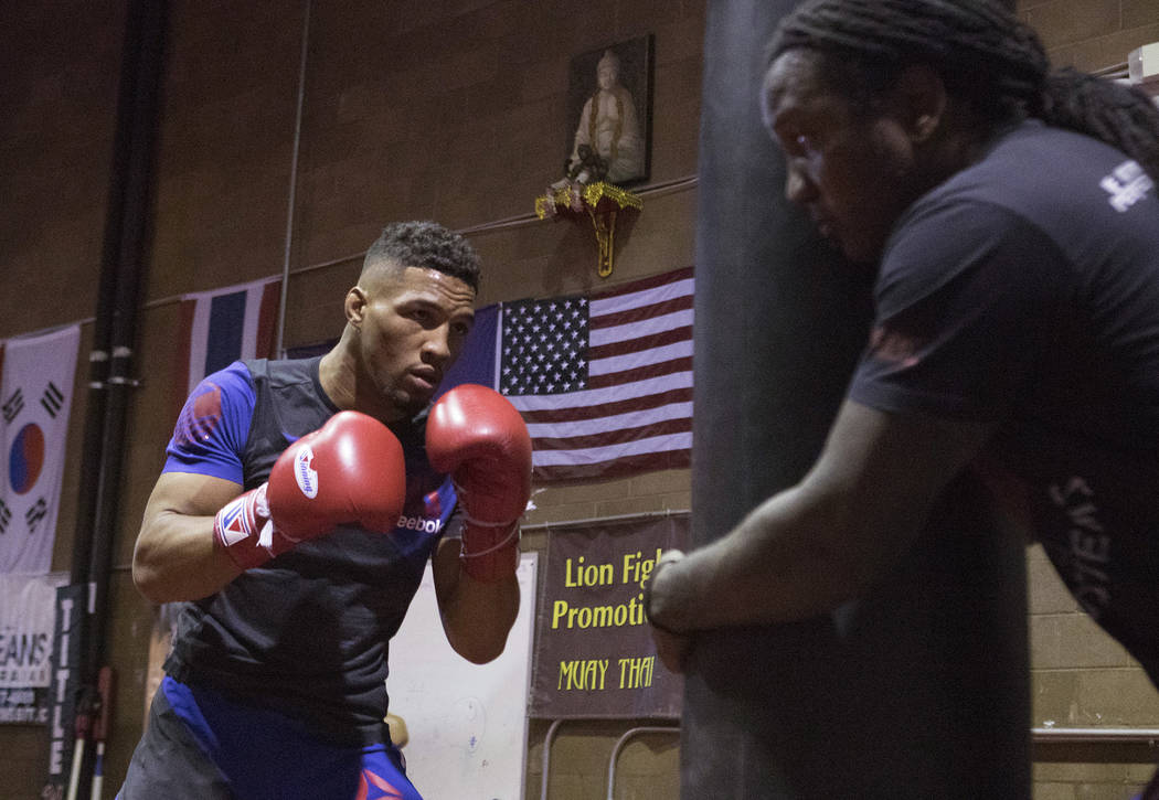 UFC lightweight Kevin Lee, left, performs heavy bag drills with his striking coach Dewey Cooper at One Kick's Gym in Las Vegas, Tuesday, June 6, 2017. Heidi Fang /Las Vegas Review-Journal @HeidiFang