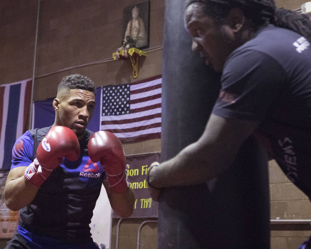 UFC lightweight Kevin Lee, left, works heavy bag drills with his striking coach Dewey Cooper at One Kick's Gym in Las Vegas, Tuesday, June 6, 2017. Heidi Fang /Las Vegas Review-Journal @HeidiFang