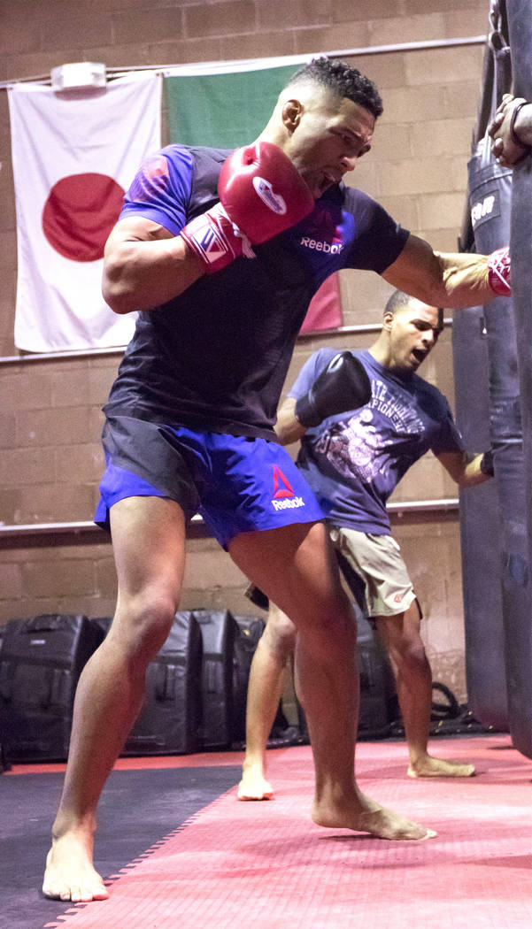 UFC lightweight Kevin Lee, left, trains for his upcoming fight hitting the heavy bag alongside his brother Keith Lee at One Kick's Gym in Las Vegas, Tuesday, June 6, 2017. Heidi Fang /Las Vegas Re ...