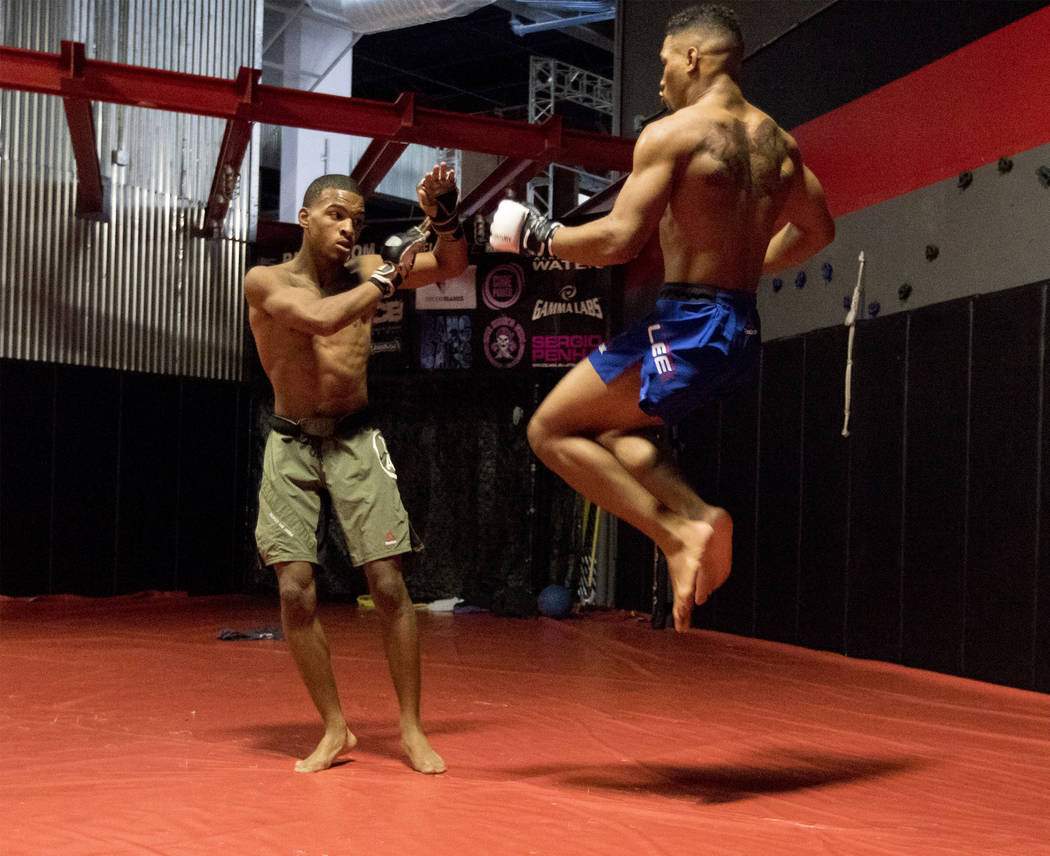 UFC lightweight Kevin Lee, right, attempts a flying knee while training with his brother Keith Lee at One Kick's Gym in Las Vegas, Tuesday, June 6, 2017. Heidi Fang /Las Vegas Review-Journal @Heid ...