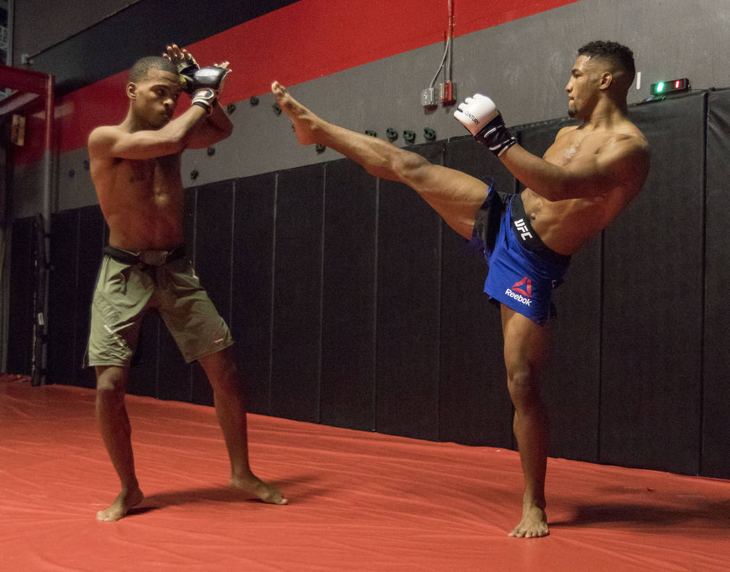 UFC lightweight Kevin Lee, right, who headlines UFC Fight Night 112, kicks while training with his brother Keith Lee at One Kick's Gym in Las Vegas, Tuesday, June 6, 2017. Heidi Fang /Las Vegas Re ...