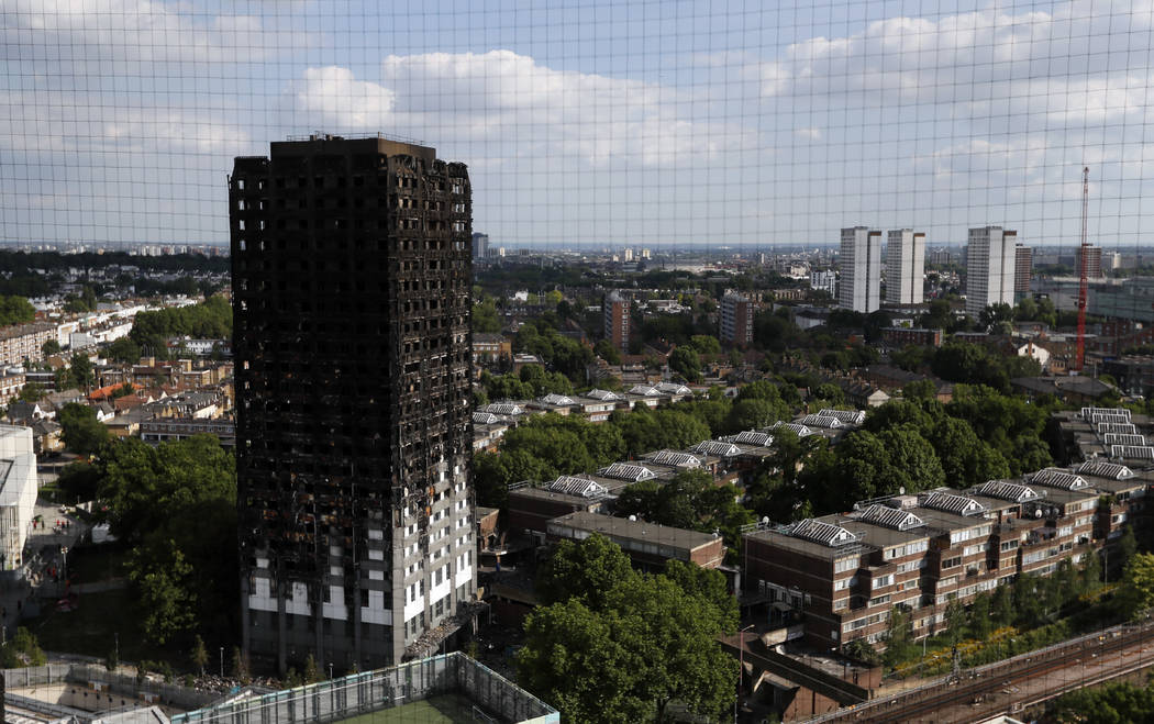 The remains of Grenfell Tower stand in London, Saturday, June 17, 2017. Police Commander Stuart Cundy said Saturday it will take weeks or longer to recover and identify all the dead in the public  ...