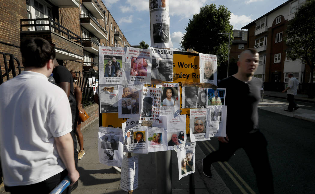 Posters of people missing are stuck to a lamp post near Grenfell Tower in London, Saturday, June 17, 2017. Police Commander Stuart Cundy said Saturday it will take weeks or longer to recover and i ...