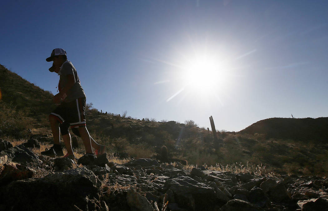 Hikers brave the afternoon sun as the temperatures hit 110-degrees Thursday, June 15, 2017, in Phoenix. Temperatures are expected to climb to 120-degrees in the metro area in the next week. (AP Ph ...