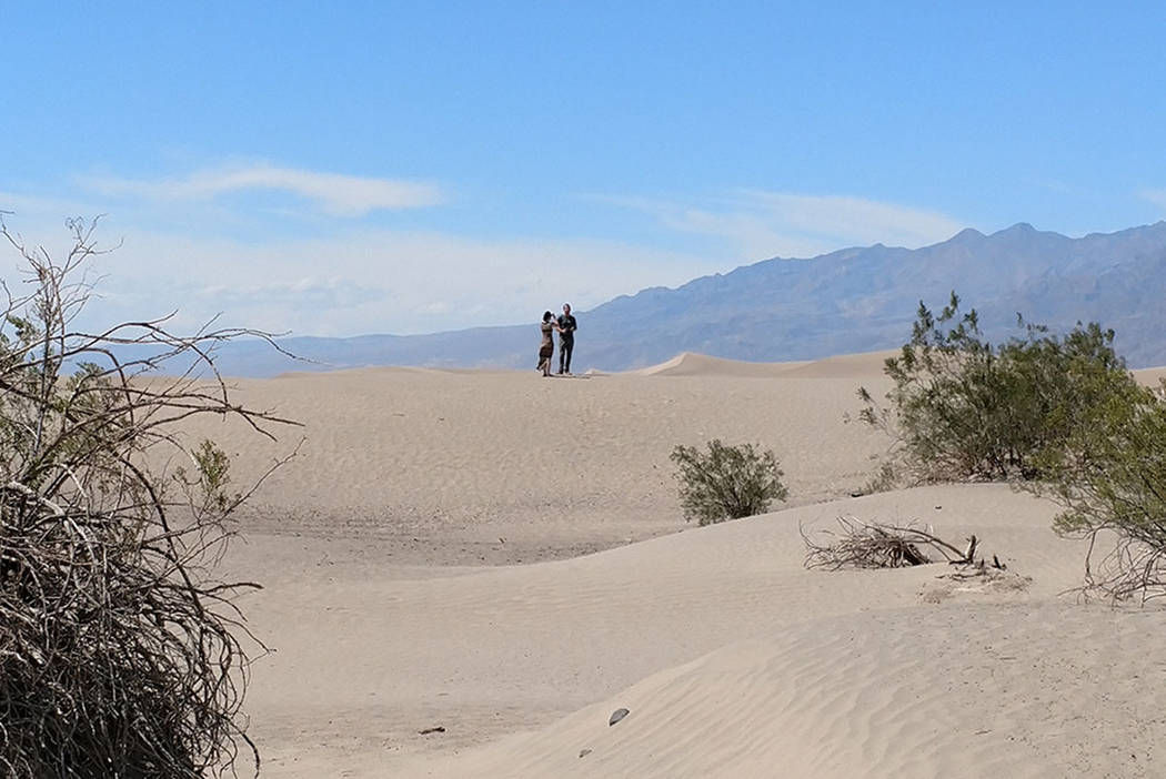 Visitors hike up the Mesquite Flat Sand Dunes at Death Valley National Park in California on Monday, June 12, 2017. (Mark Davis/Las Vegas Review-Journal)