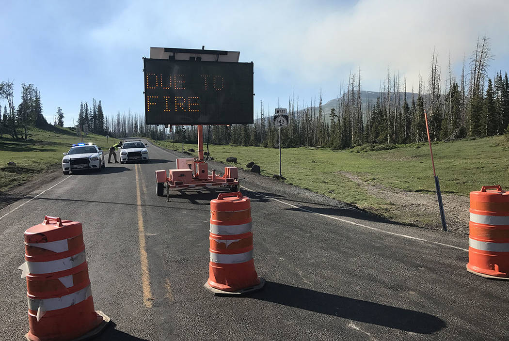 Access on the mountain road from Cedar Breaks National Monument into the Brian Head, Utah, area is blocked Sunday evening. (Greg Haas Las Vegas Review-Journal)