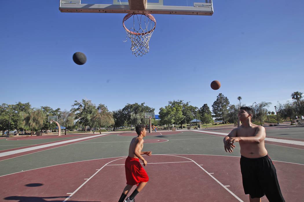 Marcuel Miller, 14, and Davion Hambrick, 16, shoot baskets at Lorenzi Park on Sunday, June 18, 2017, in Las Vegas. Rachel Aston Las Vegas Review-Journal @rookie__rae