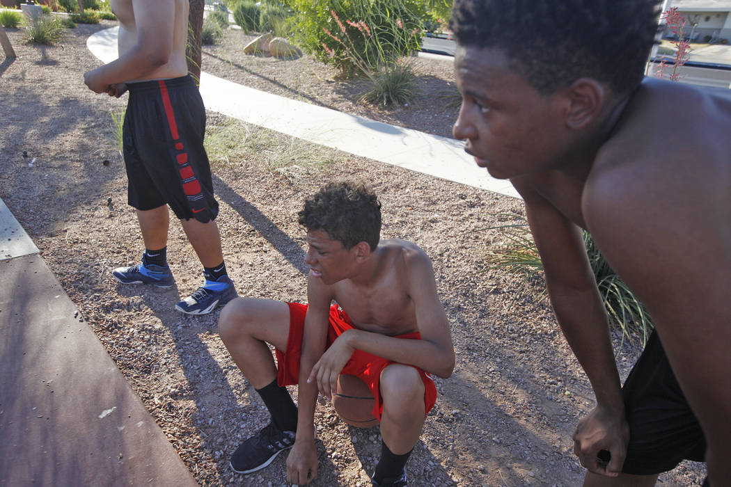 Marcuel Miller, 14, and Davion Hambrick, 16, rest after shooting hoops at Lorenzi Park on Sunday, June 18, 2017, in Las Vegas. Rachel Aston Las Vegas Review-Journal @rookie__rae