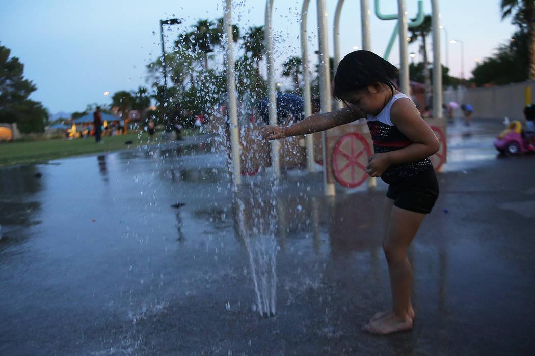 Chelsea Yanez, 4, plays in the water park at Lorenzi Park on Sunday, June 18, 2017 in Las Vegas. Rachel Aston Las Vegas Review-Journal @rookie__rae