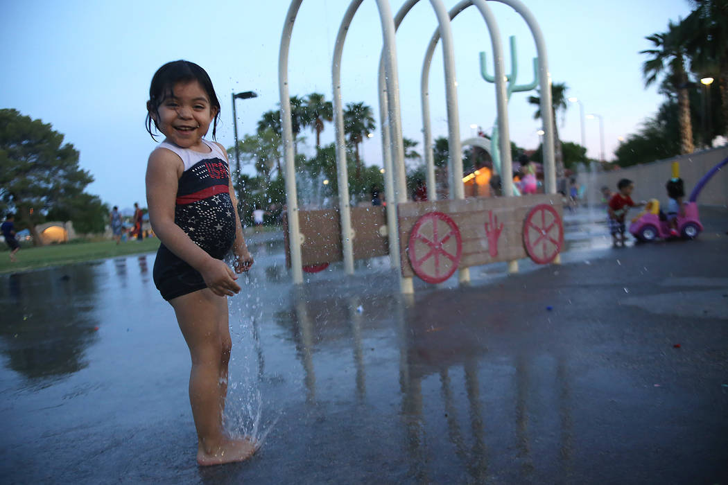 Chelsea Yanez, 4, plays in the water park at Lorenzi Park on Sunday, June 18, 2017 in Las Vegas. At 8p.m. it was still 108 degrees, as Vegas continues through a heat wave. Rachel Aston Las Vegas R ...