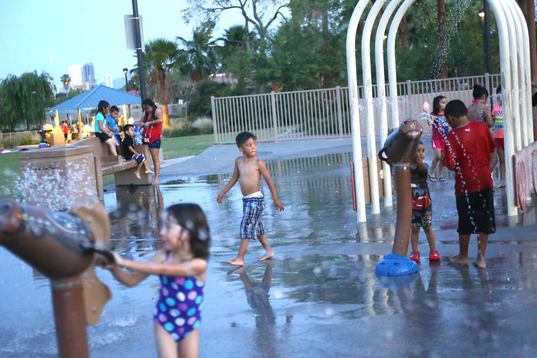 Children play in the water park at Lorenzi Park on Sunday, June 18, 2017 in Las Vegas. At 8p.m. it was still 108 degrees, as Vegas continues through a heat wave. Rachel Aston Las Vegas Review-Jour ...