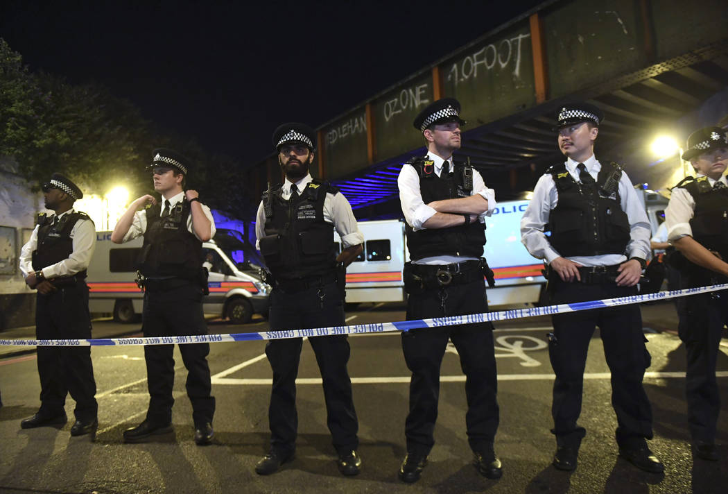 Police officers man a cordon near the Seven Sisters Road at Finsbury Park where a vehicle struck pedestrians in London Monday, June 19, 2017. Police say a vehicle struck pedestrians on a road in n ...
