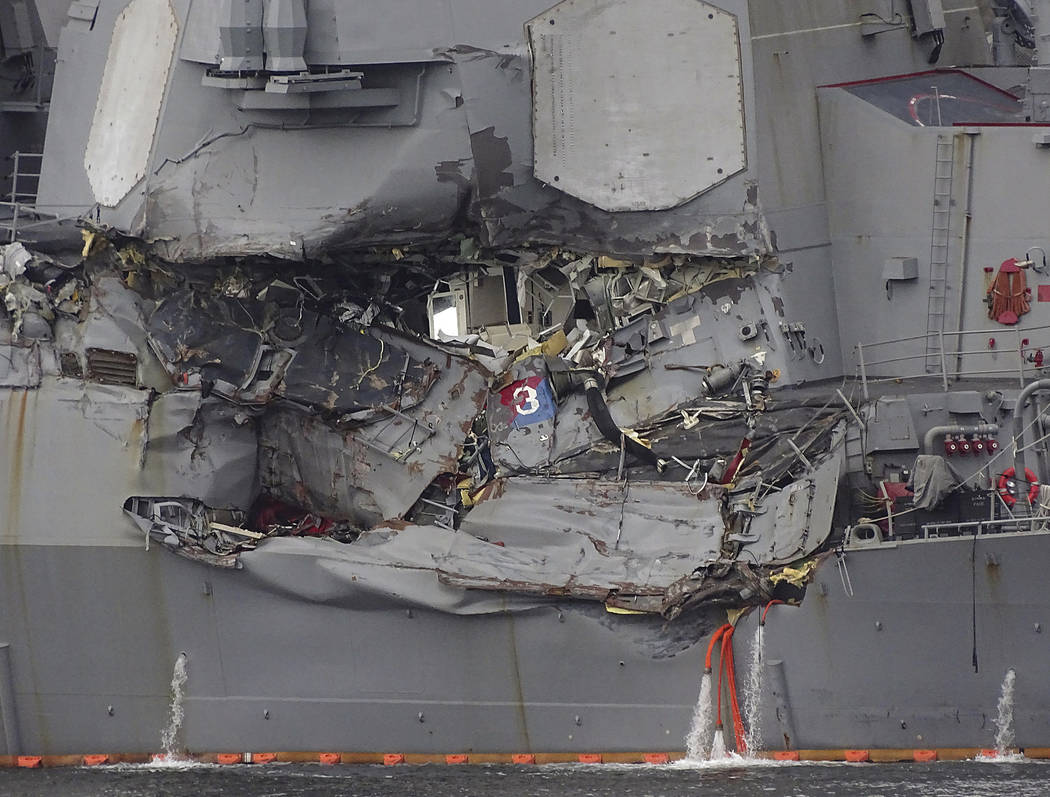 Damaged part of USS Fitzgerald is seen at the U.S. Naval base in Yokosuka, southwest of Tokyo Sunday, June 18, 2017.  Navy divers found a number of sailors' bodies Sunday aboard the stricken USS F ...