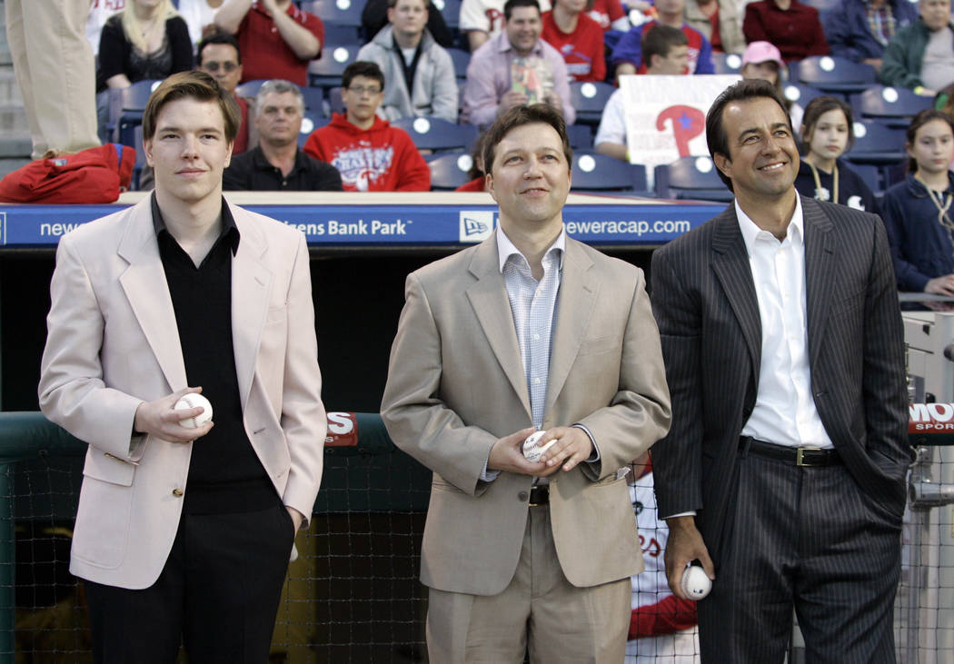 Kane, Brad and Todd Kalas, left, to right, the sons of Hall of Fame Philadelphia Phillies broadcaster Harry Kalas, who died suddenly Monday, April 13, at the age of 73, watch a video tribute to th ...