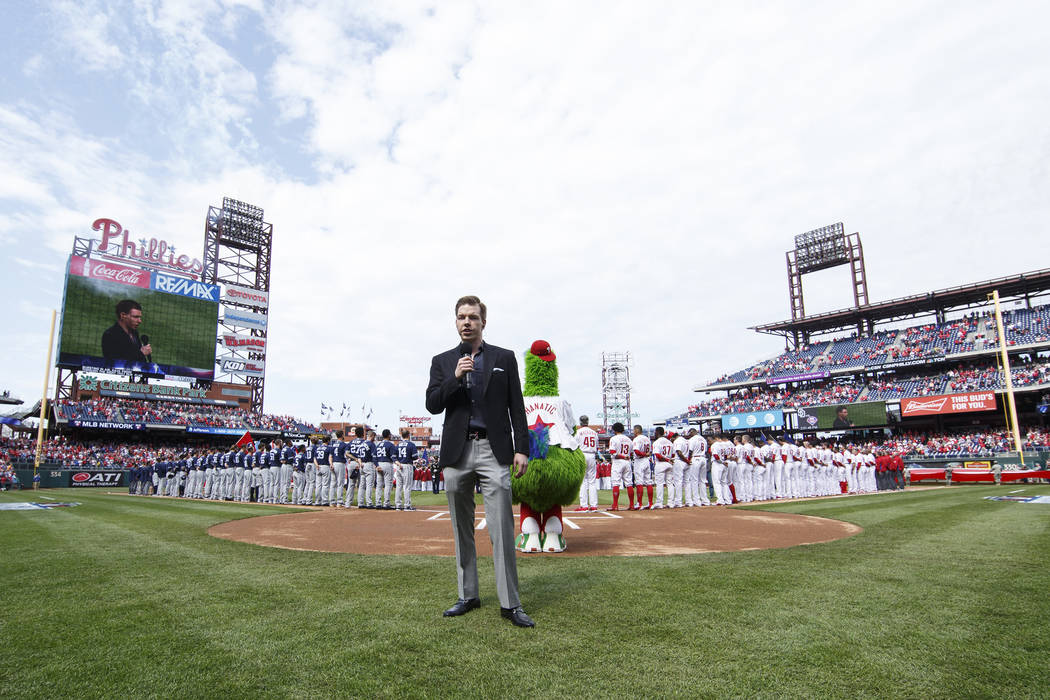 Kane Kalas sings the National Anthem prior to the first inning of an opening day baseball game between the San Diego Padres and the Philadelphia Phillies, Monday, April 11, 2016, in Philadelphia.  ...