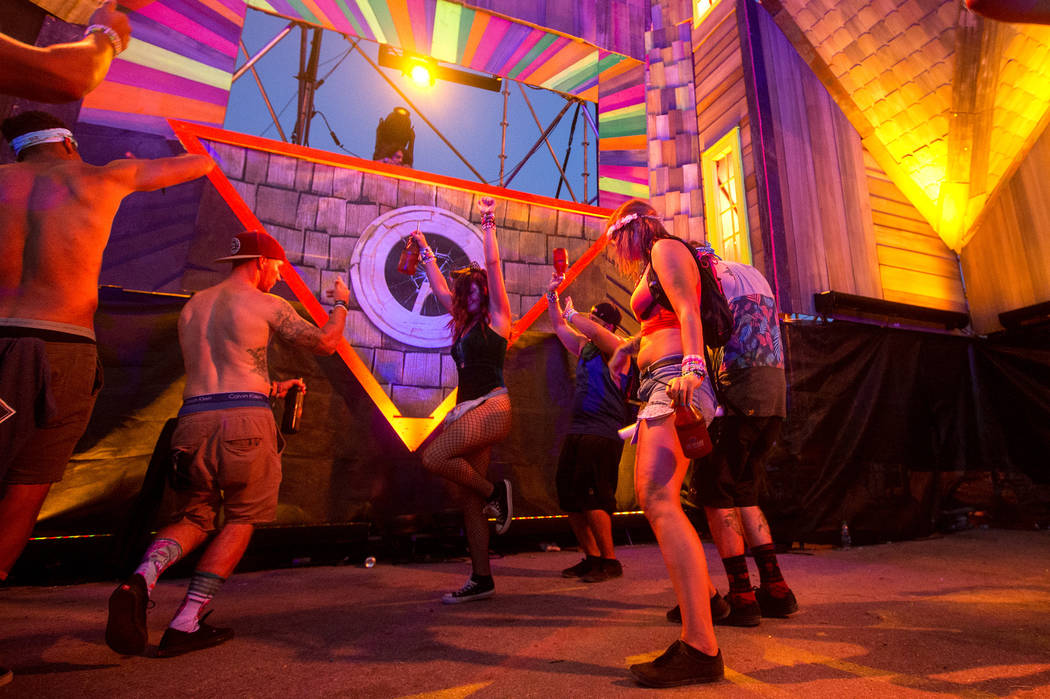 Sage Armstrong plays at the Upside-down House while attendees dance on the last night of Electric Daisy Carnival at Las Vegas Motor Speedway on Sunday, June 18, 2017 in Las Vegas. Bridget Bennett  ...
