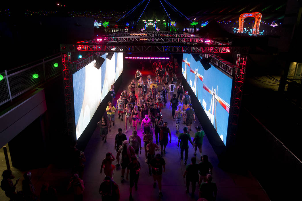 Attendees make their way through the festival grounds on the last night of Electric Daisy Carnival at Las Vegas Motor Speedway on Sunday, June 18, 2017 in Las Vegas. Bridget Bennett Las Vegas Revi ...