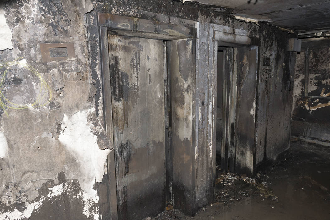 Burned-out elevators on an undisclosed floor in the Grenfell Tower, Sunday, June 18, 2017, after fire engulfed the 24-story building in London. Experts believe the exterior cladding, which c ...