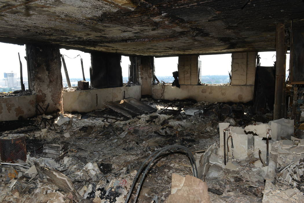 A view of an apartment in the Grenfell Tower, Sunday, June 18, 2017, after fire engulfed the 24-story building in London. Experts believe the exterior cladding, which contained insulation, h ...
